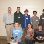 The 2013 THS Botball ®Team Back: Advisor Mr. Drenkard, Dan Yankura, Jack Tinker, Sam Nguyen, Mason DeMelo Front: Tommy Daly, Grace Forster, Greg St Germain and the robots