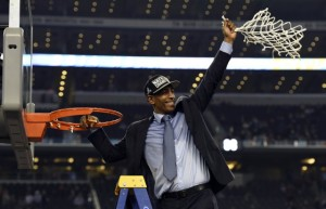 First-year UConn head coach Kevin Ollie  cuts the net after winning the championship. Photo courtesy of Robert Deutsch - USA TODAY Sports.