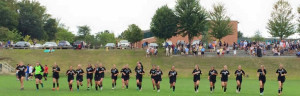 Girls soccer runs a lap of the field after the game, celebrating their win. Photo courtesy of Meghan Mahar.