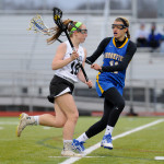 Sophomore Shannon Siebold takes the ball down the field past Brookfield's Savannah Ryan.