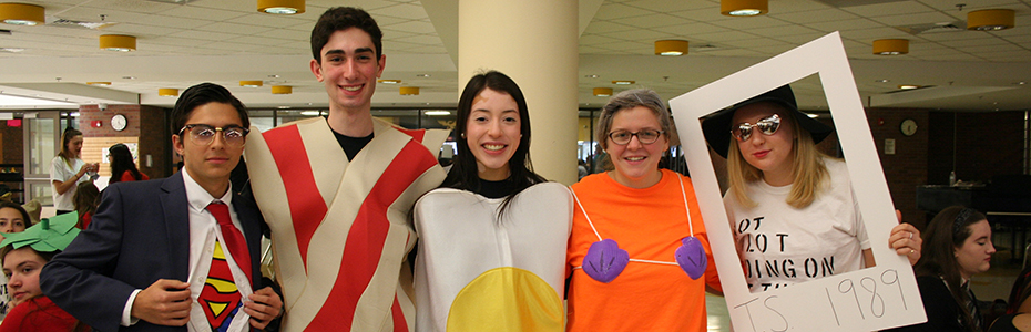 Dylan Koury, Jacob Fried, Victoria Estacio, Erin Walsh, and Natalia Paskevicz pose as Superman, bacon, eggs, Mermaid Man, and Taylor Swift.